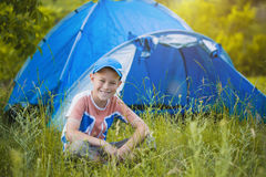 Kid with a tent on a camomile meadow Royalty Free Stock Images