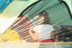 Kid in a tent Stock Images
