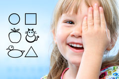 Kid testing vision with symbols. Royalty Free Stock Image