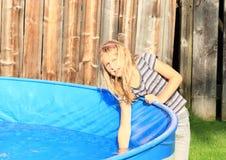 Kid testing water in pool Stock Images