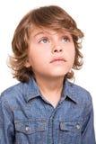 Kid thinking over white Stock Image