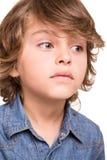 Kid thinking over white Stock Photos