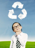 Kid thinking about recycling stock photos
