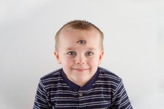 Kid with three eyes royalty free stock photography