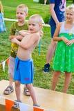 Kid throwing balls at a target Royalty Free Stock Image
