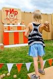 Kid throwing balls at a target Royalty Free Stock Photography