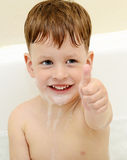 Kid with thumb up. In bath Stock Photos