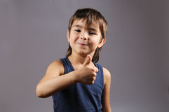 Kid with a thumbs up Stock Photos