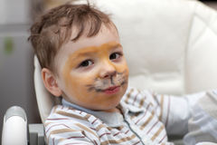 Kid with tiger face Stock Photos