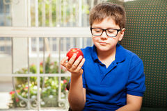 Kid about to eat an apple Stock Images