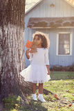 Kid toddler girl with autumn leaf playing outdoor Royalty Free Stock Photo