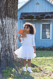 Kid toddler girl with autumn leaf playing outdoor Royalty Free Stock Photography