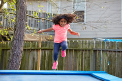 Kid toddler girl jumping on a trampoline Royalty Free Stock Images