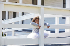 Kid toddler girl playing hiding behind a fence Royalty Free Stock Photography