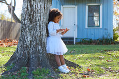 Kid toddler girl with tablet pc playing outdoor Royalty Free Stock Images