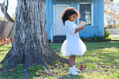 Kid toddler girl with tablet pc playing outdoor Royalty Free Stock Photo