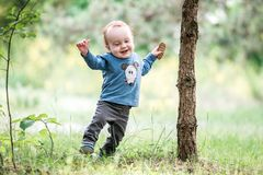 Kid toddler in park, happy expression stock photo