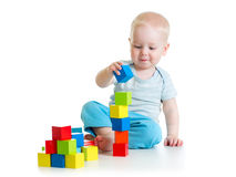 Kid toddler playing with building block toys Stock Image