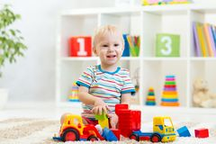 Kid toddler playing with toy car Stock Photography