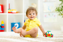 Kid toddler playing with toy car Royalty Free Stock Image