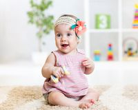 Kid toddler playing with toy indoors Royalty Free Stock Photography