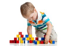 Kid toddler playing wooden blocks toy isolated on white royalty free stock image