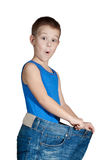 Kid in too big jeans Royalty Free Stock Image