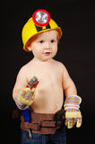 Kid with tools. Young boy, 20 months old, playing with construction tools Stock Photos
