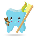 Kid tooth with toothbrush and teddy bear Stock Photo
