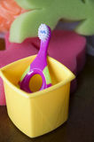 Kid toothbrush. Colorful toothbrush for kid in bathroom Royalty Free Stock Image