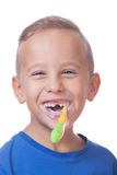 Kid with toothbrush. Portrait of a smiling kid with a toothbrush royalty free stock image