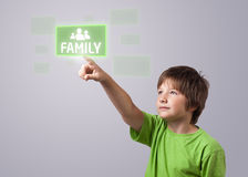 Kid touching FAMILY button Royalty Free Stock Photography