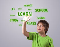 Kid touching LEARN button Stock Image