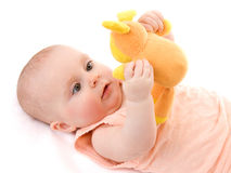 The kid with a toy. Stock Images