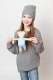 Kid and toy bear Stock Photos