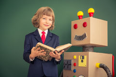 Kid with toy robot in school Royalty Free Stock Image
