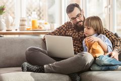 Kid and father watching movie Royalty Free Stock Photo