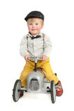 Kid with toy tractor Stock Image