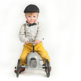 Kid with toy tractor Royalty Free Stock Photos