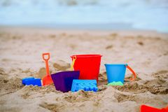 Kid toys on tropical sand beach, family vacation. Concept royalty free stock image