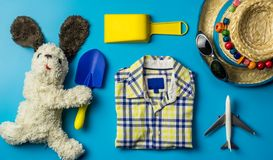Kid travel objects concept on blue. Background Stock Photography