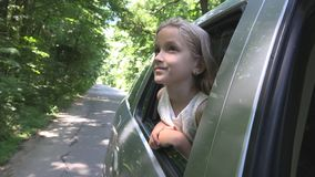 Kid Traveling by Car, Child Face Looking Out the Window, Girl Admiring Nature royalty free stock photos
