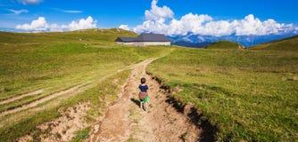 Kid trekking on mountain stock photo