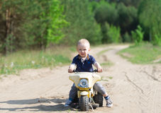 The kid on a tricycle. Stock Photo