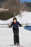 Kid try cross-country skiing on the white snow in the mountains Royalty Free Stock Photography