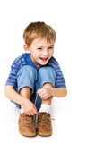 Kid try to tie shoelaces. Happy child try to tie shoelaces royalty free stock images