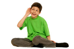 Kid trying to hear more Royalty Free Stock Images