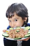 Kid with tuna Royalty Free Stock Photo