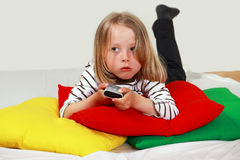 Kid with TV remote Stock Images