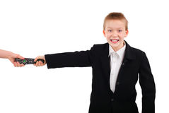 Kid with TV set Remote Control Royalty Free Stock Photography